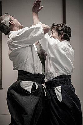 Caucasian people practicing martial arts - p555m1479724 by Adam Crowley