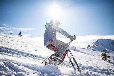 France, Man riding skibike - p1007m2216537 by Tilby Vattard