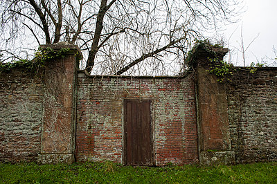 Door in an old red brick wall - p1047m1041625 by Sally Mundy
