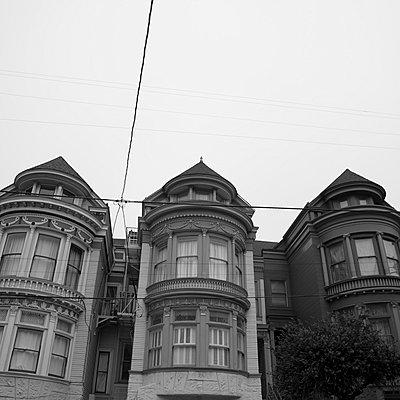 Three Victorian houses - p495m833356 by Jeanene Scott