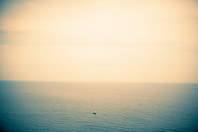 Sailing boat on calm sea - p5282784 by Dan Lepp