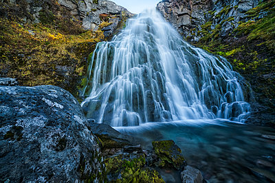 Waterfall along the road; West Fjords, Iceland - p442m2004290 by Robert Postma