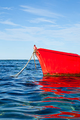 Red boat lies at anchor - p304m1222280 by R. Wolf