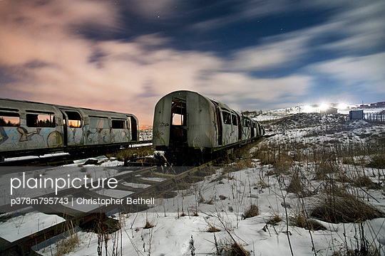 Ruined trains at night - p378m795743 by Christopher Bethell