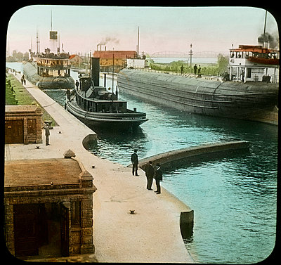 Greatest Canal Traffic in the World, Soo Canal, Sault Ste. Marie, Michigan, USA, Magic Lantern Slide, circa 1915 - p694m992728 by Circa Images