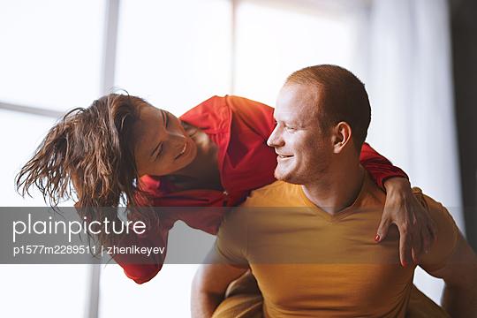 Redhead man and Asian woman having fun - p1577m2289511 by zhenikeyev