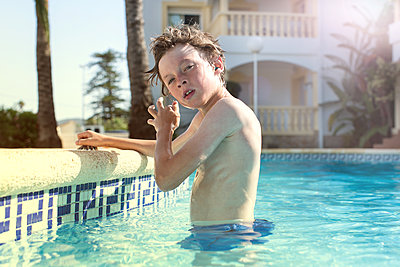 Boy in Swimming pool - p1520m2082016 by Michael Leckie