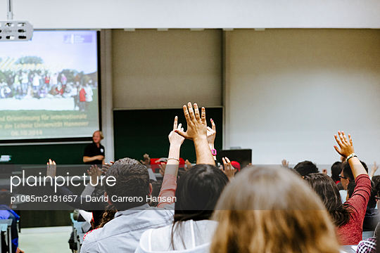 Students put their hands up in a seminary, Leibniz University - p1085m2181657 by David Carreno Hansen