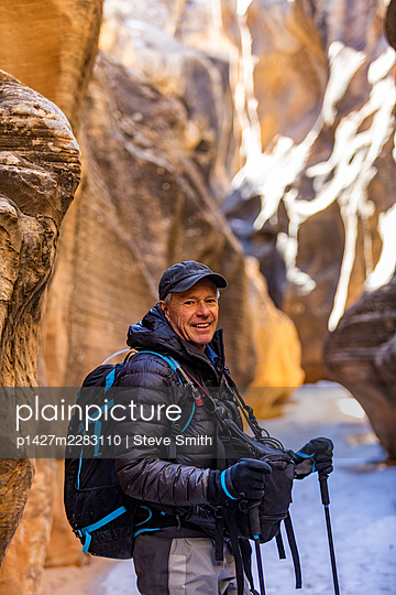 USA, Utah, Escalante, Man hiking in slot canyon in Grand Staircase-Escalante National Monument - p1427m2283110 by Steve Smith
