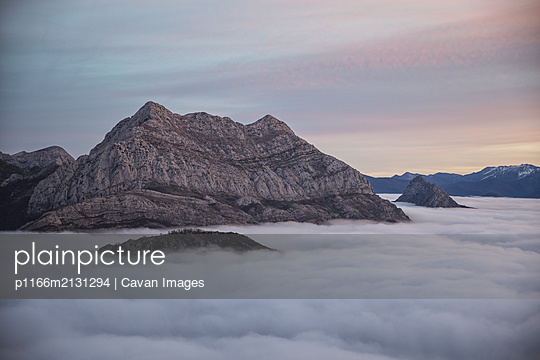 Mists at sunrise from the top of some mountains - p1166m2131294 by Cavan Images