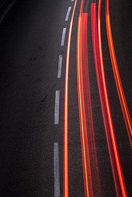 Red light trails left by car lights - p1682m2260740 by Régine Heintz