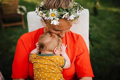 Smiling woman hugging baby - p312m2280795 by Stina Gränfors