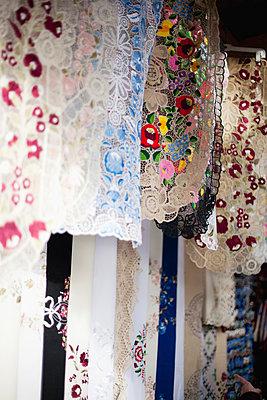 Close-up of laces hanging - p312m996572f by Elisabeth Zeilon