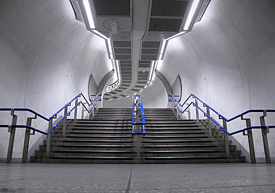 Underground tube steps inside Kings Cross station - p1072m829326 by Neville Mountford-Hoare