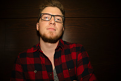 Portrait confident, cool male hipster millennial - p1192m1583686 by Hero Images