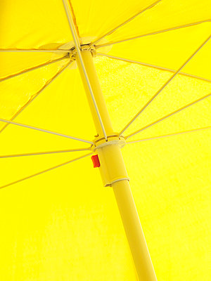 Close-up low-angle view of yellow sunshade - p31227534f by Peter Carlsson