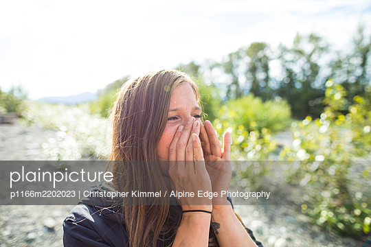 Young woman shouting - p1166m2202023 by Christopher Kimmel / Alpine Edge Photography