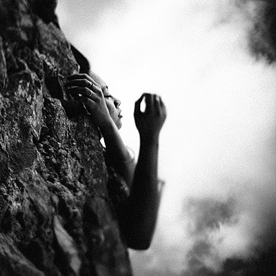 Woman leaning on a rock - p1616m2187723 by Just - Schmidt