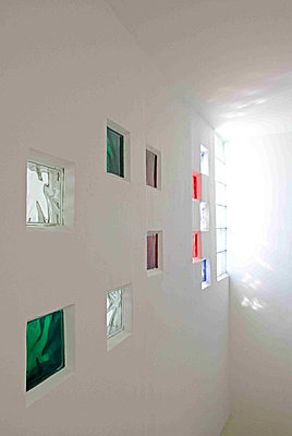 White wall with color glass bricks - p349m790775 by Polly Eltes