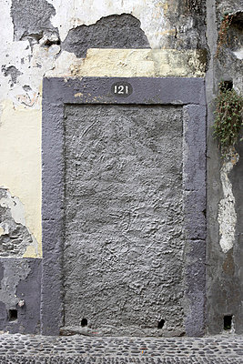 Sealed doorway with peeling paint in Madeira, Portugal. - p8552381 by Richard Bryant