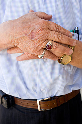 Close up of hands of an elderly; senior man - p5350267 by Michelle Gibson