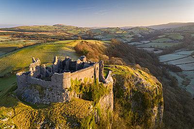 Aerial vista by drone of Carreg Cennen Castle, Brecon Beacons National Park, Carmarthenshire, Wales, United Kingdom, Europe - p871m2209423 by Adam Burton