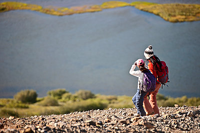 Mother and daughter ascending from mountain at Lake Myvatn - p1166m2235379 by Cavan Images