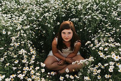 Girl in flower field - p1507m2168004 by Emma Grann