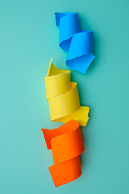 Brightly coloured curls of paper - p1228m2216404 by Benjamin Harte