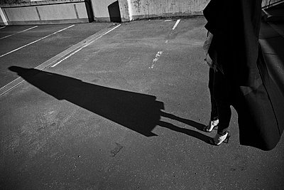 A Sharp Shadow Of A Woman In High Heels And Black Coat.   - p847m987964 by Johan Strindberg