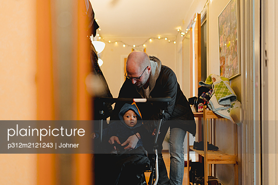 Father with son - p312m2121243 by Johner