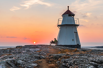 Lighthouse at sunset - p312m2051959 by Mikael Svensson