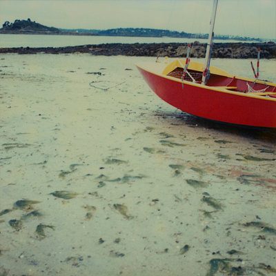 Boat on sand at low tide - p6750235 by Michele Constantini