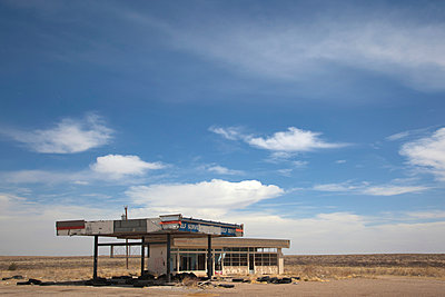 Abandoned gas station on Route 66. - p1072m906723f by Anthony Worobiec