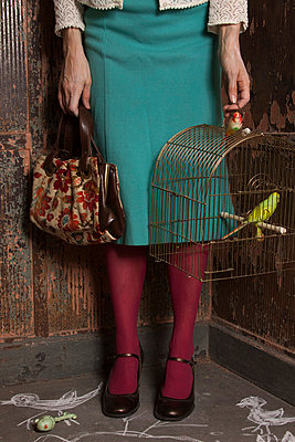 Woman with birdcage - p8370006 by Cornelia Hediger