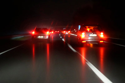 Driving by night at wintertime on motorway - p300m980737f by Nabiha Dahhan
