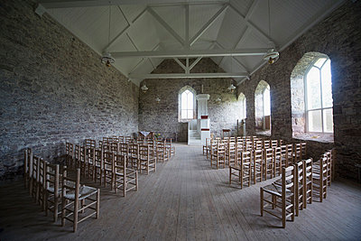 Interior of stone church with rows of chairs, Applecross Peninsula, Highlands, Scotland, UK - p442m784457 by John Short