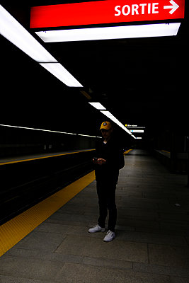 Young man in the subway - p1105m2086521 by Virginie Plauchut