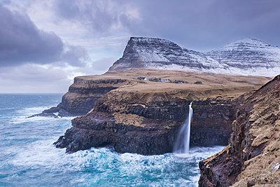 Wintry conditions at Gasadalur on the island of Vagar, Faroe Islands, Denmark, Europe - p871m1048040 by Adam Burton
