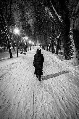 Going for a stroll at night in winter - p890m2045444 by Mielek