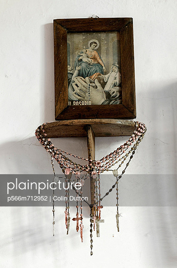 Roman catholic rosary and picture of the Madonna
