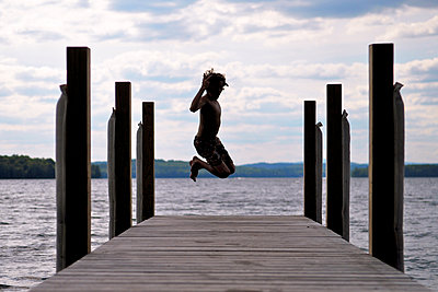 Boy Jumps off Boardwalk - p1304m1136833 by MY MY