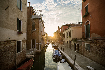 Italy, Venice, Gondolas in canal at sunset - p352m1127280f by Mickael Tannus