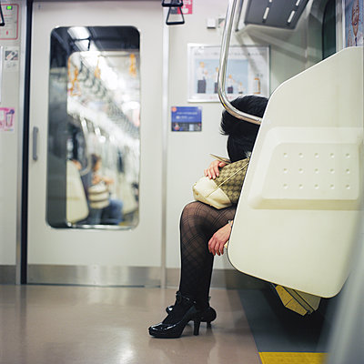 A woman sleeping in the Tokyo's metro - p1610m2195819 by myriam tirler
