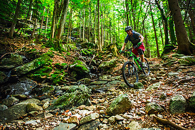 Mountain biker rides through a rock garden in Chamonix, France. - p343m1090325 by Elias Kunosson