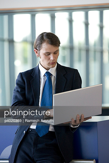 Young business man with laptop