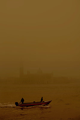 Two men on a boat, Venice, Italy - p1028m1588897 by Jean Marmeisse