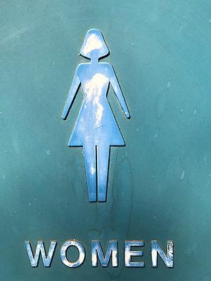Worn Women toilet door - p1048m2025624 by Mark Wagner