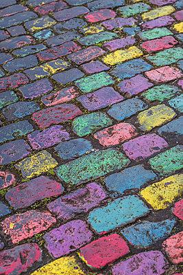 Portugal, Azores, Sao Miguel Island, Ponta Delgada, colored cobblestones - p651m2006698 by Walter Bibikow