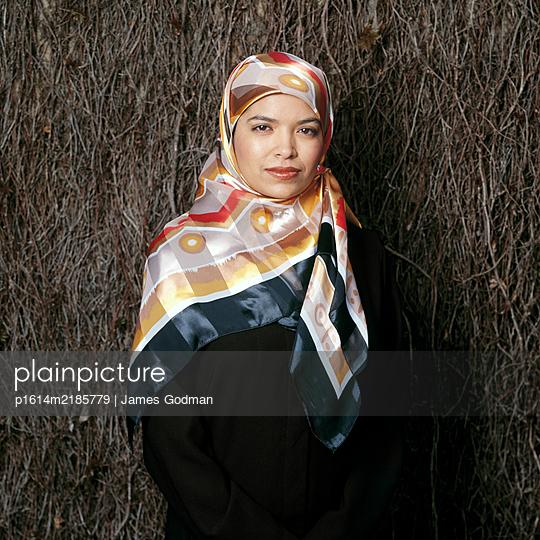Confident Muslim Woman staring at camera - p1614m2185779 by James Godman